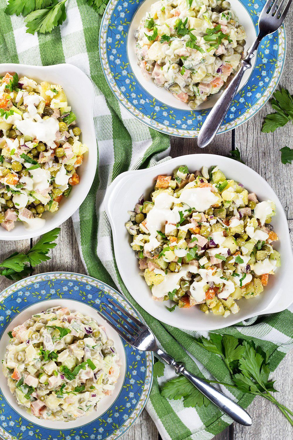 Olivier Salad, also known as Russian Potato Salad, is one of the most famous Russian foods. It is hearty, comforting, filling, and super delicious! | cookingtheglobe.com #olivierrussischersalat Olivier Salad, also known as Russian Potato Salad, is one of the most famous Russian foods. It is hearty, comforting, filling, and super delicious! | cookingtheglobe.com #olivierrussischersalat