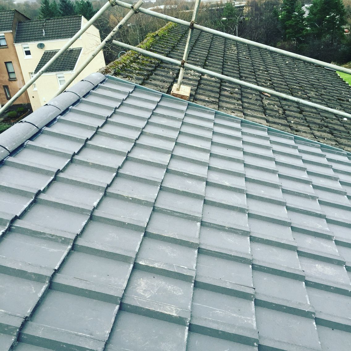 Re roofing installation using marley wessex concrete roof for Cement tile installation
