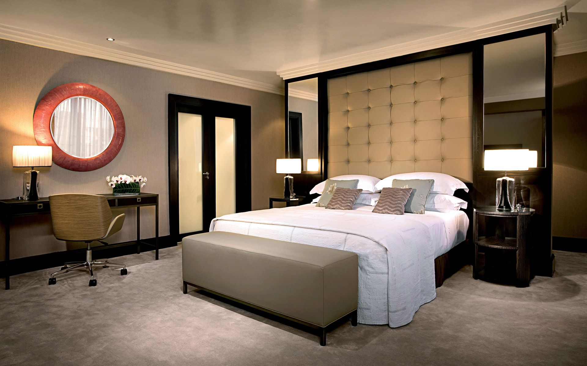 Contemporary High Tufted Gray Vinyl Like Leather Headboard With Gray Bench As Well As White Shade Table Lamps And Double Frosted Door In Modern Brown Bedroom Ideas