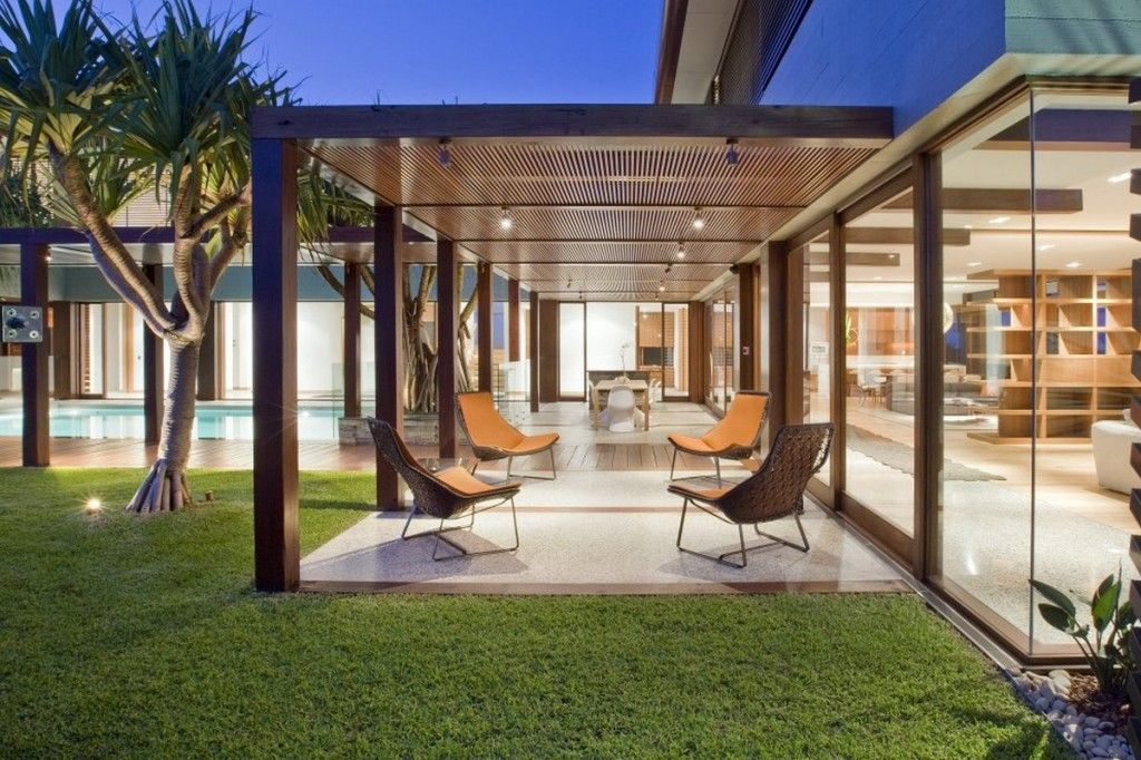 Cozy Warm Patio Of Beach Residence With Modern Lounge Chairs And Timber Colonnade Open To The