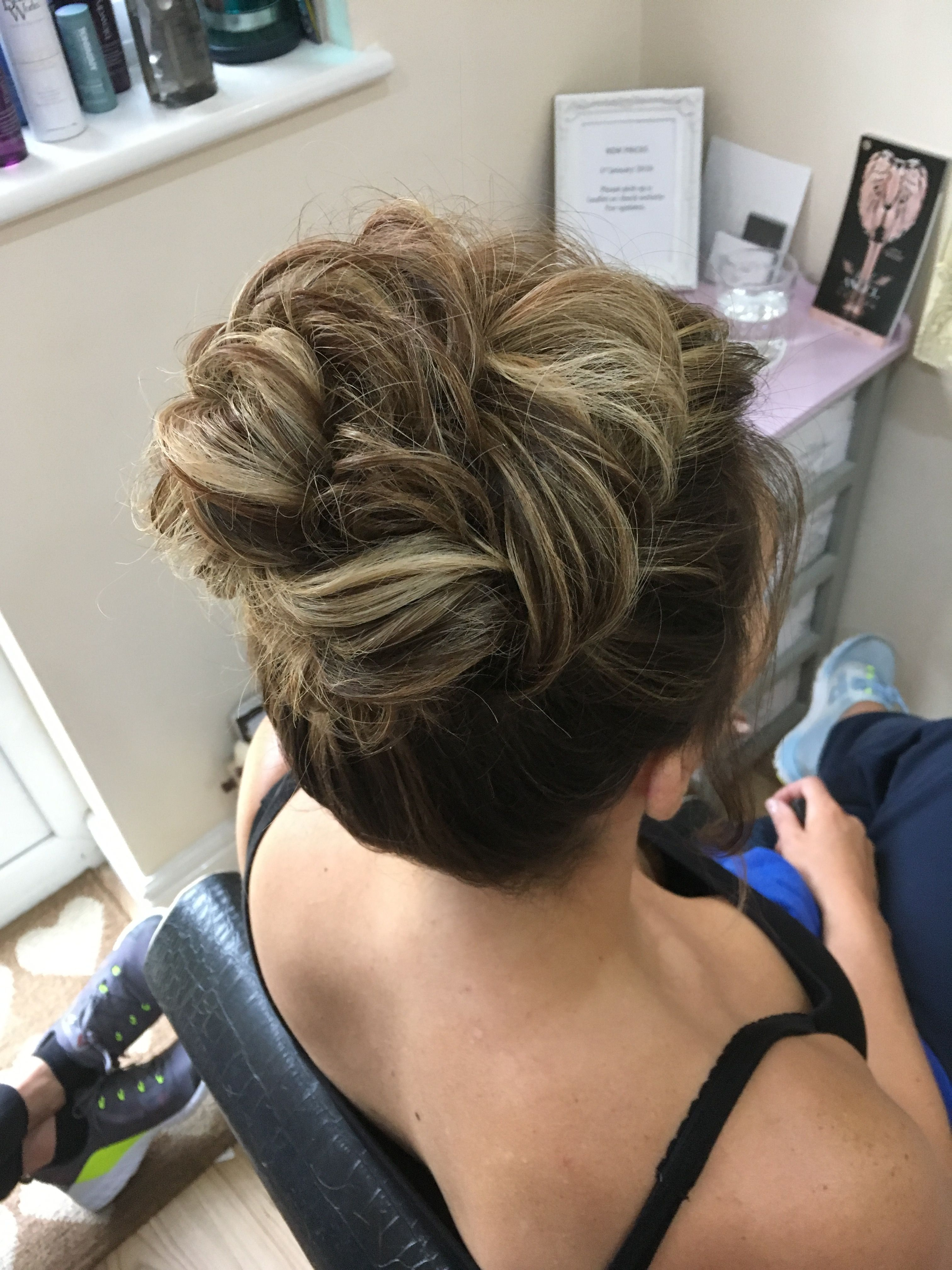 soft high updo piled high undone look for wedding guest