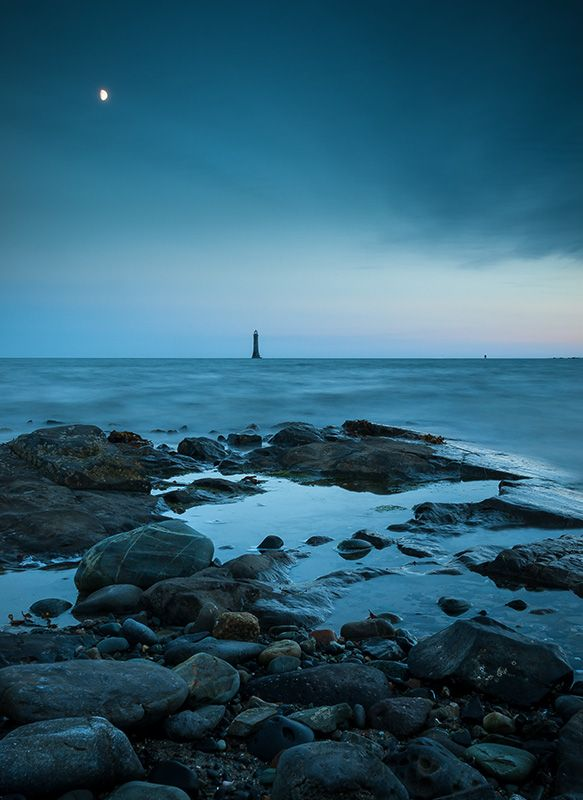 Night time falls at Cranfield Beach looking out towards Haulbowline Lighthouse. The lighthouse is the main sea light and also serves to guide vessels from seaward through the entrance channel into Carlingford Lough.