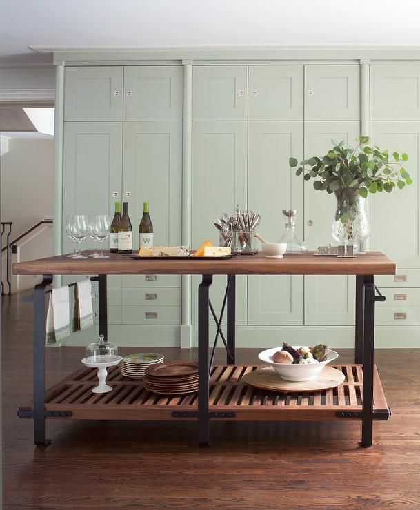 Lovely Kitchen Boasts A Wall Of Floor To Ceiling Mint Green Delectable Kitchen Island Cabinet Design Inspiration