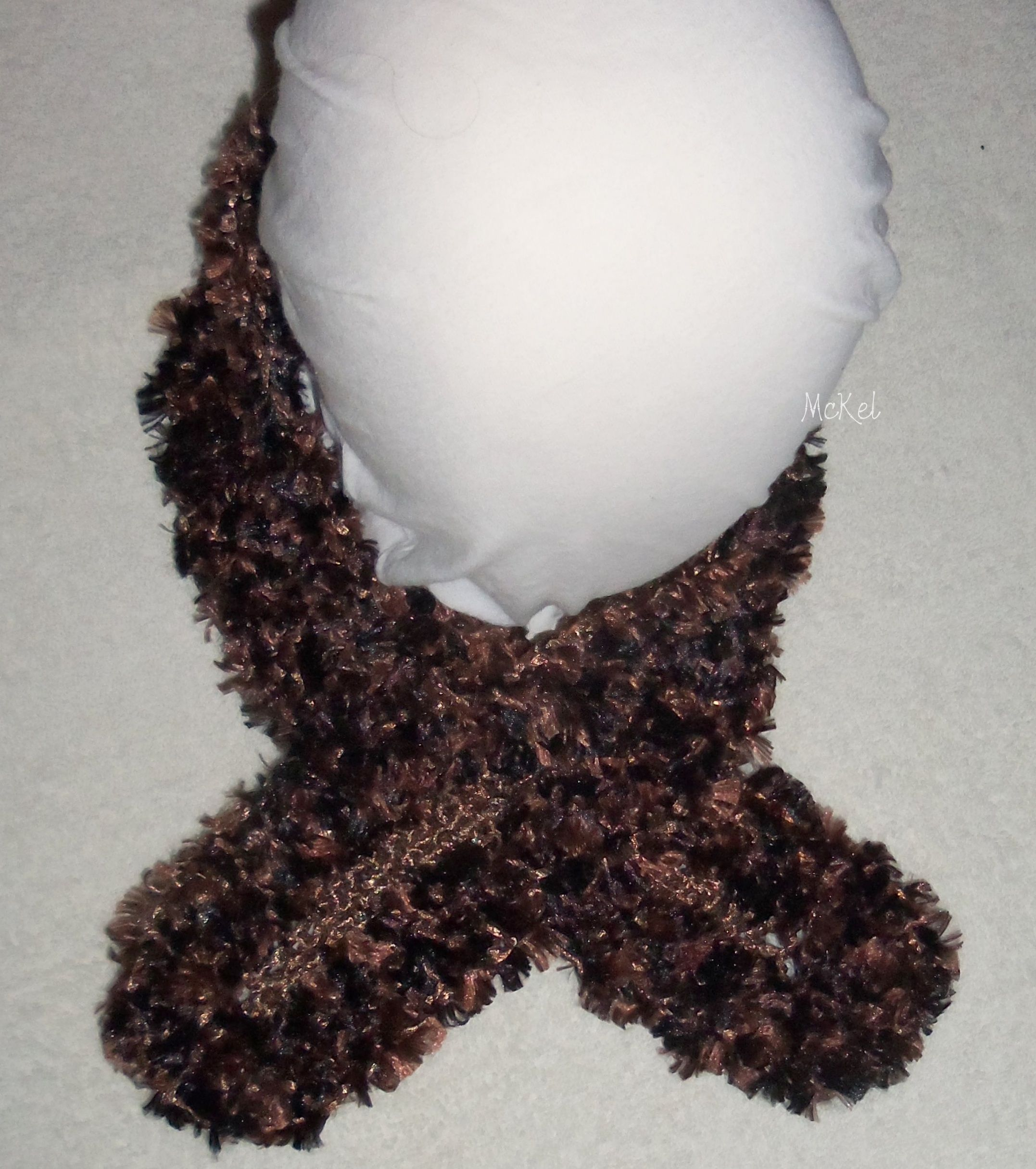 Neck scarf.  to wear tucked inside your coat collar.  this is made with two strands of yarn, a 'metallic style' and an 'eyelash style'. the color combination is similar to chocolates and gold combined.  Very soft to the touch and stitched for warmth.  One only, can make additional, will have to locate yarn to make, place your orders early!  and Thank you.... photo 1