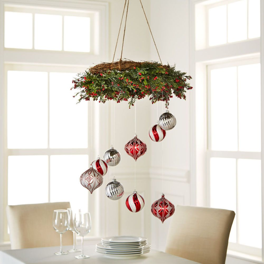 Hang ornaments from a wreath to create this unusual holiday decor hang ornaments from a wreath to create this unusual holiday decor chandelier arubaitofo Gallery