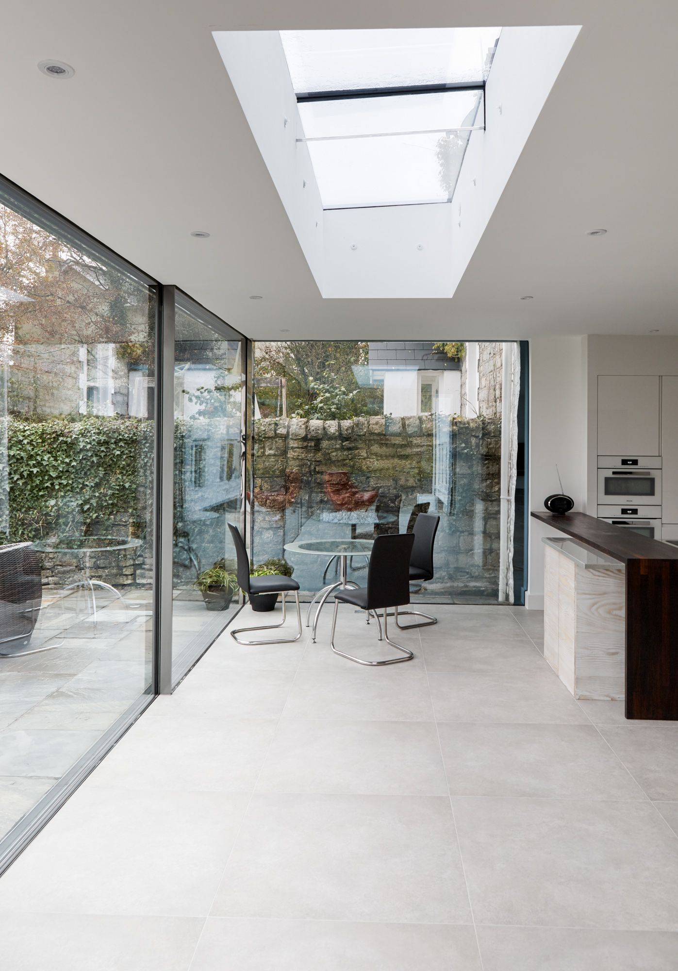 Open Plan Contemporary Kitchen Extension To The Rear Of An