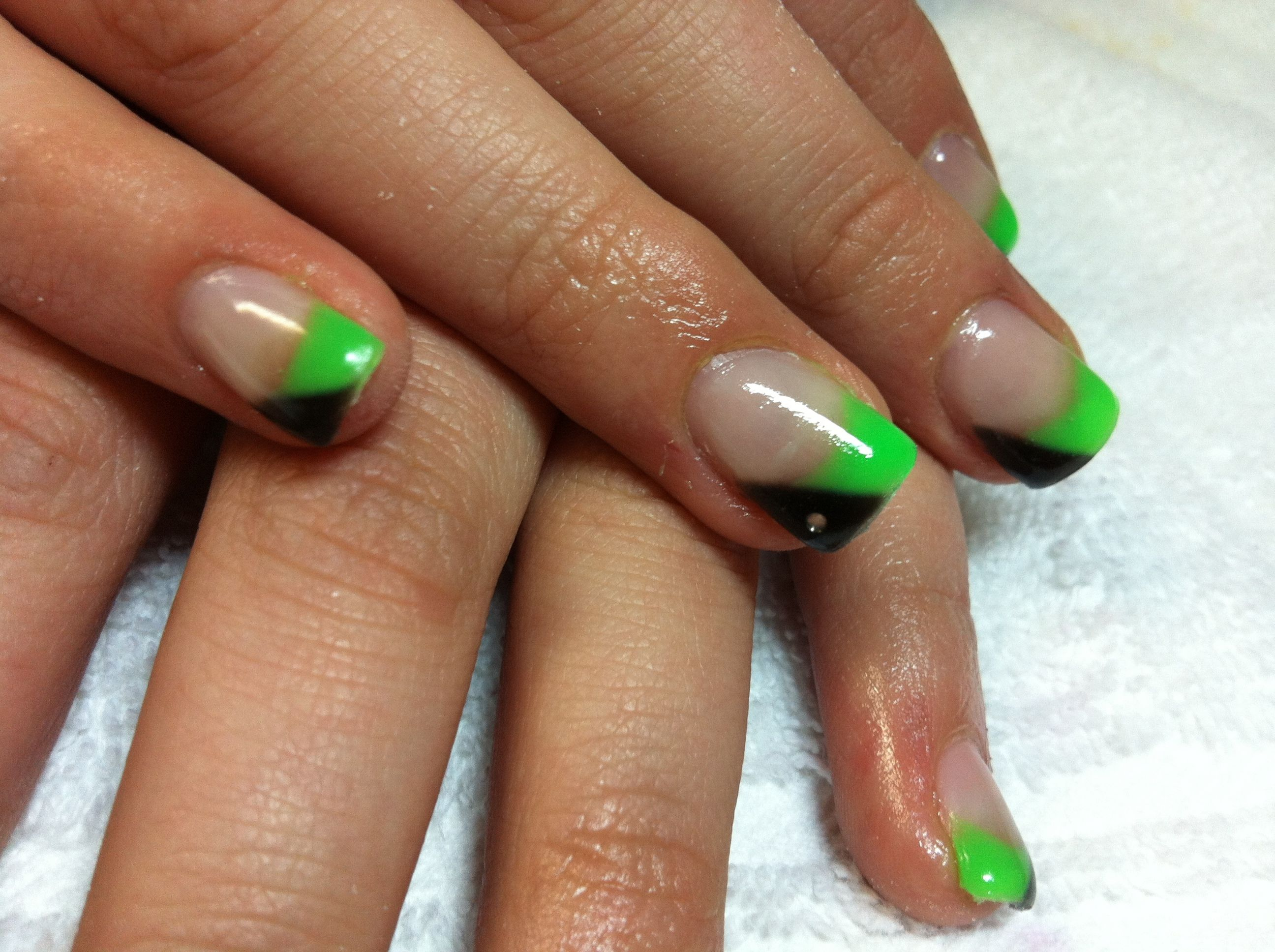 Check out these amazing half green half black nails with the silver ...