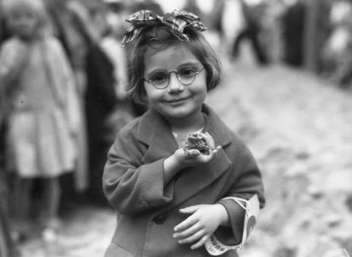 A Little Girl and Her Pet Toad at a Pet Fair 1936