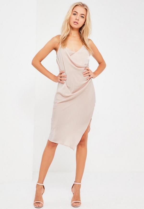 Slip into something silky and step up your evening game wearing this beaut' nude dress, featuring cami straps and wrap deets.