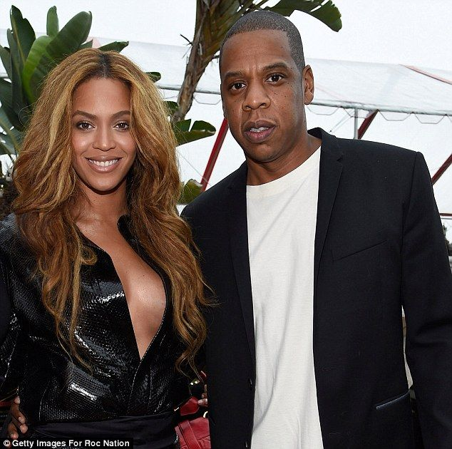 5f3c4fd064 Beyonce holds court in a daring low cut top with husband Jay Z