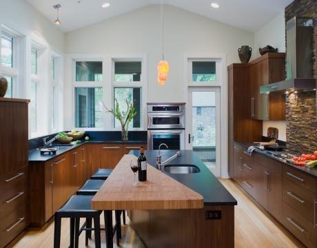 Wood Meets Stone In This Creative Island Countertop By Jennifer Gilmer Kitchen Bath Kitchen Design Eco Friendly Kitchen Design Zen Kitchen