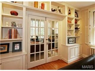 Built-ins surround french doors leading to office