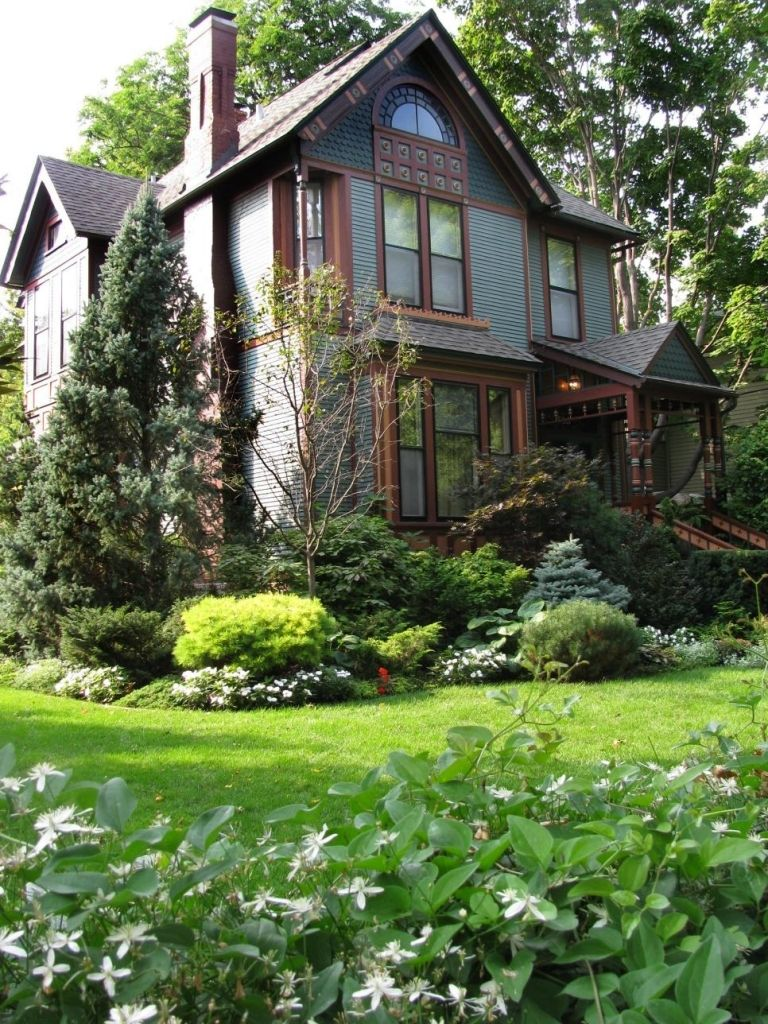 Awesome in addition to gorgeous landscaping front yard for property