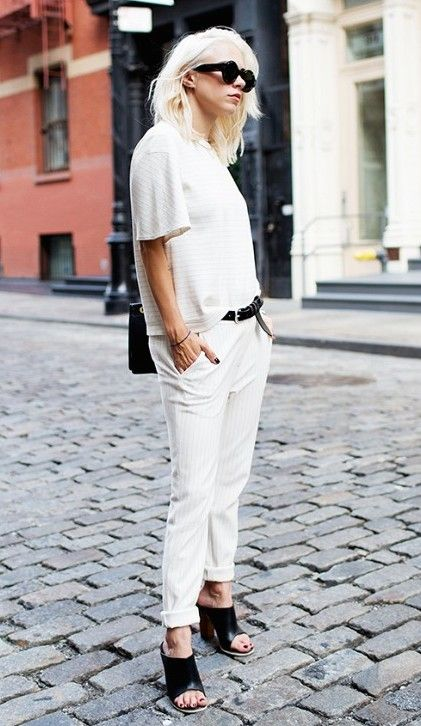 Loving Courtney Trop's all-white two-piece look, and how she offsets it with black accessories.