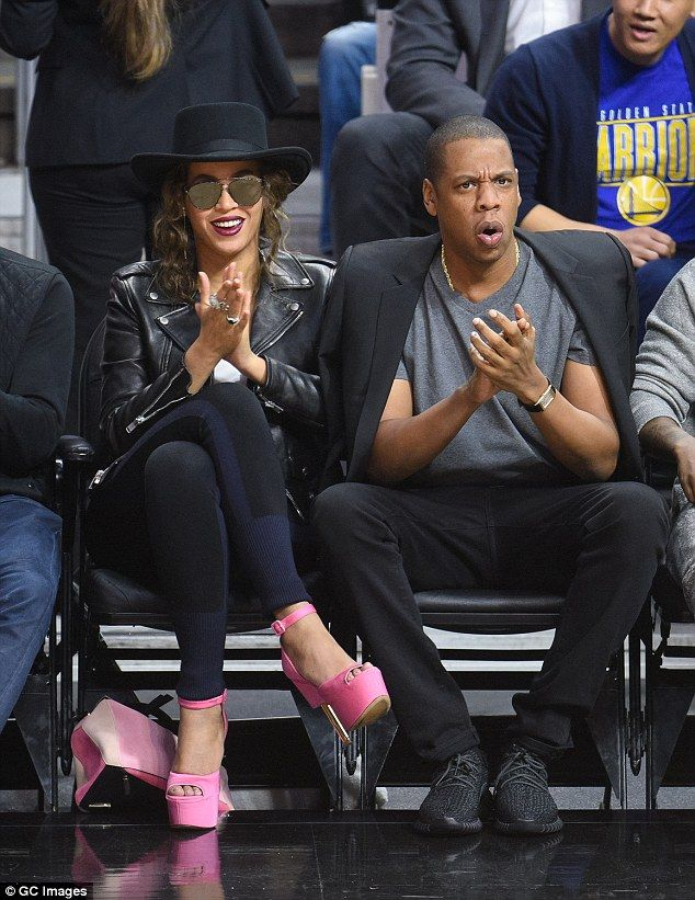 e02838303 Beyonce s pink platform heels took the spotlight as she and husband Jay Z  watched the Los Angeles Clippers play the Golden State Warriors at the  Staples ...