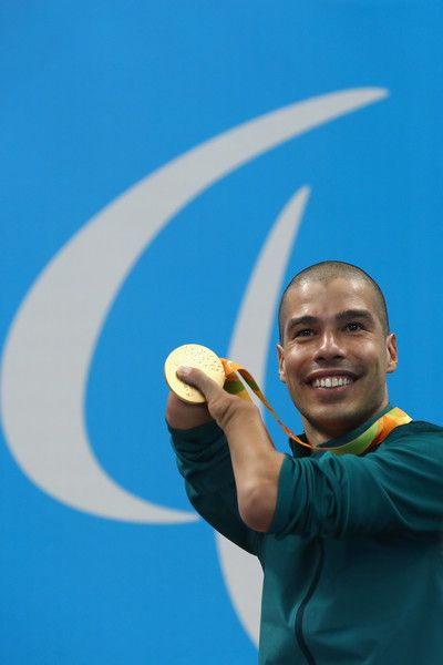 Gold medalist Daniel Dias of Brazil celebrates on the podium at the medal ceremony for the Men's 200m Freestyle - S5 Final on day 1 of the Rio 2016 Paralympic Games at the Olympic Aquatics Stadium on September 8, 2016 in Rio de Janeiro, Brazil.