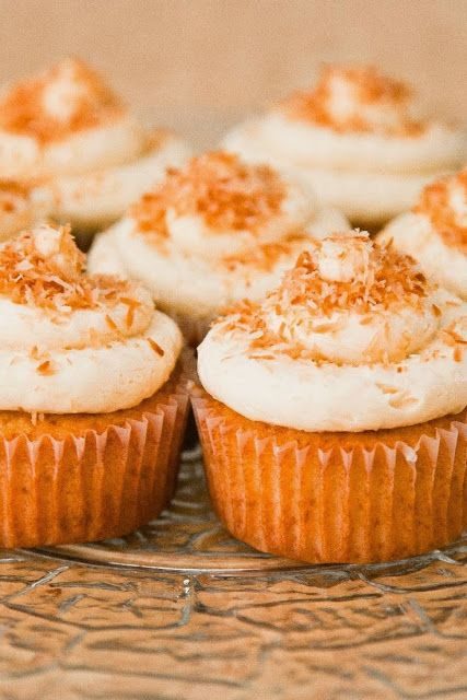 Coconut Cupcakes with Coconut Cream Cheese Frosting ~ These cupcaes are light, fluffy and delicious