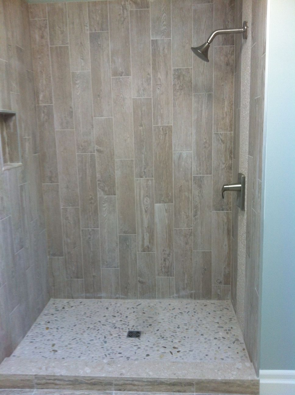 Wood Grain Tile With River Rock Wood Tile Shower Shower Tile Bathroom Shower Design