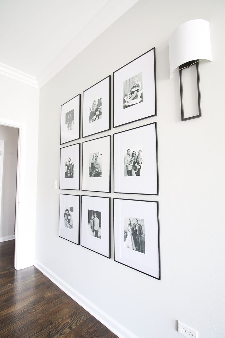 Symmetrical gallery wall in the hallway. Every home should have some art and personal photographs on the walls. But framing art and choosing the best mat can be tricky. Here are my tips to display your art the right way! #artwork #framing #frames #homedecor #homeaccessories