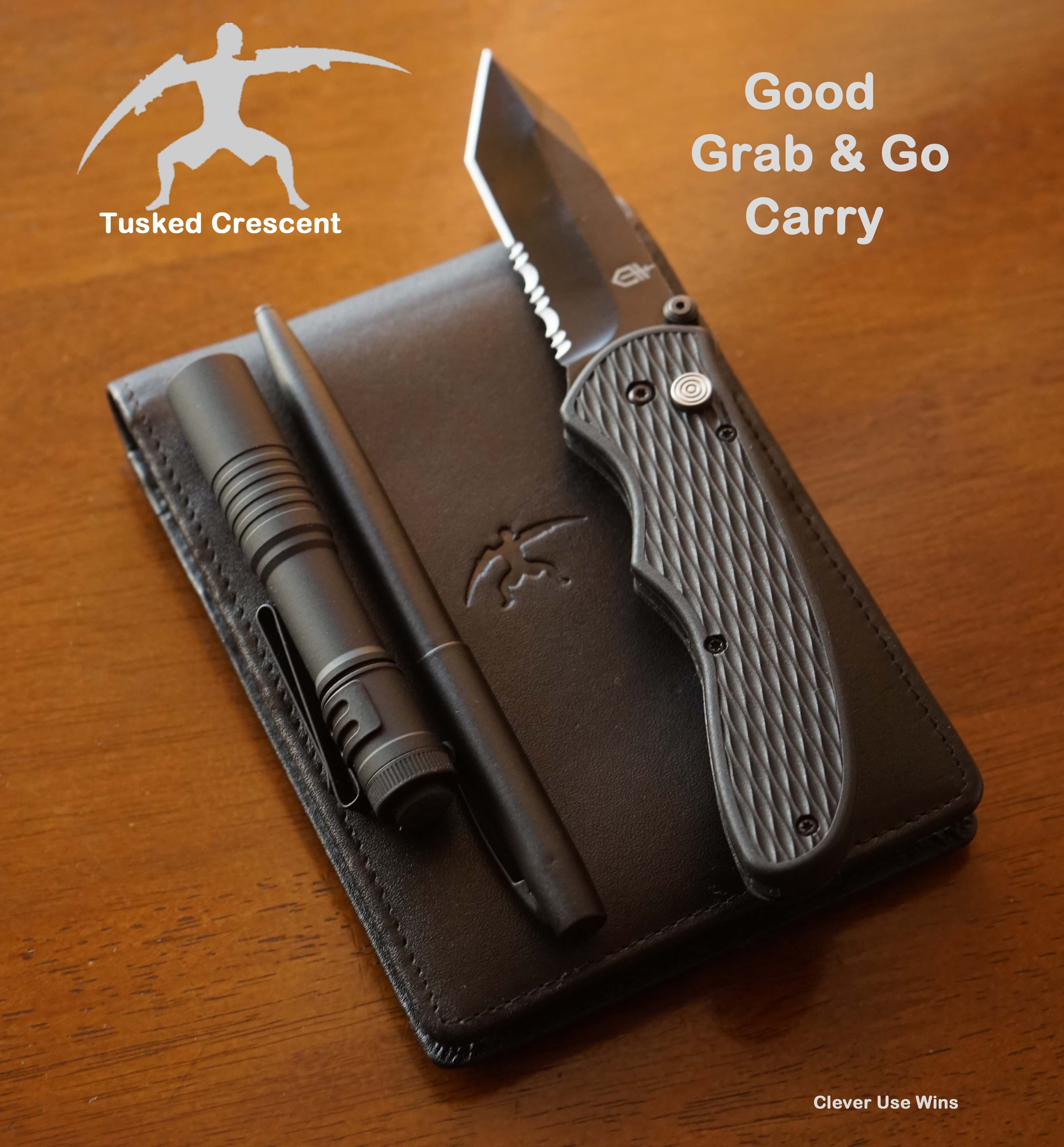 Good Grab & Go Carry Tusked Crescent Pocketbook $24 with