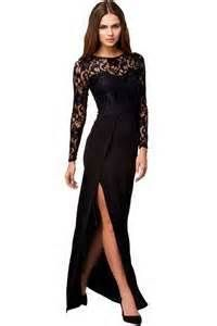 Black dress with maxi skirt with thigh slit. Semi see-through black lace covers back, upper chest and arms