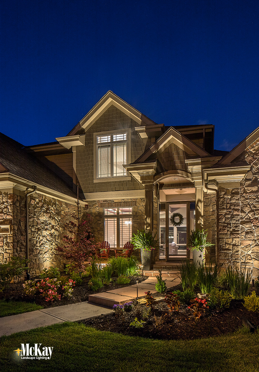 In Front Of The Home We Illuminated Its Beautiful Stone And Architectural Features See More Photo Of Th Entryway Lighting Landscape Lighting Outdoor Entryway