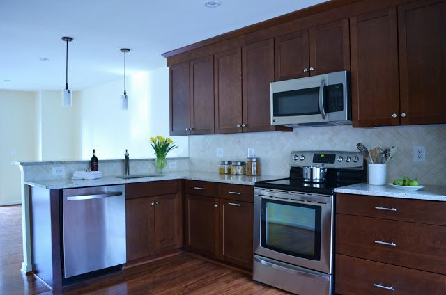 uptodate kitchen remodel with granite countertops dark off white