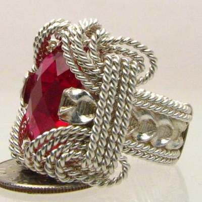 "Handmade Wire Wrap Solid Sterling Silver Man Made Ruby Ring 18x13mm (3/4x1/2 inch) 10+ct Sizing and shipping are free and a 14 day ""No Questions Asked"" return policy. This ring is made with real gems. I made it myself, so if you see a setting you like and want a different gem in it, I can put in another one as they are not finished. I can probably do it for the same price or real close. I can make these either in gold or sterling silver; just email me for a price"