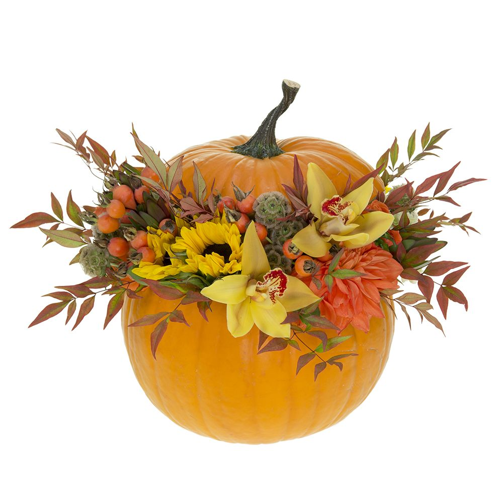 Beautiful autumn pumpkin centerpiece with fresh flowers.  Fall colors.  Orchids, Rose hips, Dahlias, Fall leaves