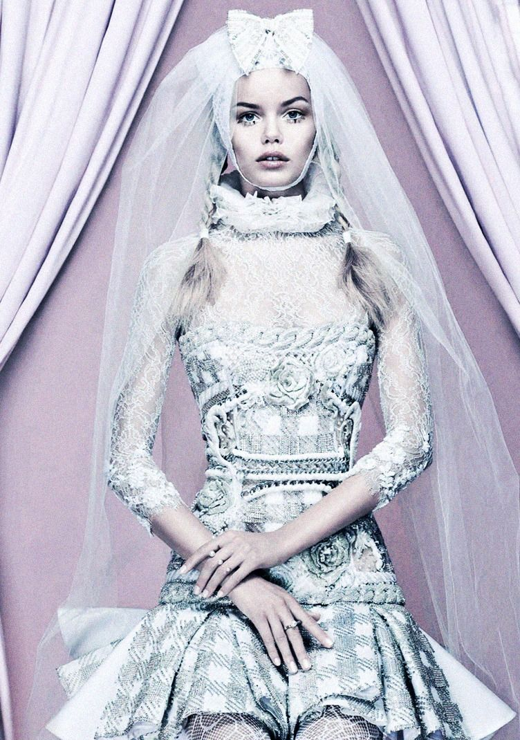 Frida Aasen wears bustier & skirt from Balmain Resort 2014 in the wedding-cake-esque editorial 'Cruise To The Altar' shot by Anthony Maule f...
