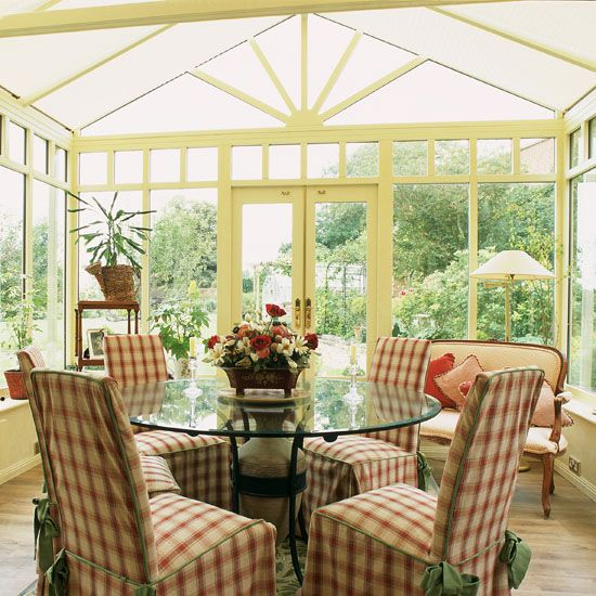 Traditional conservatory dining room with neutral walls and floors ...