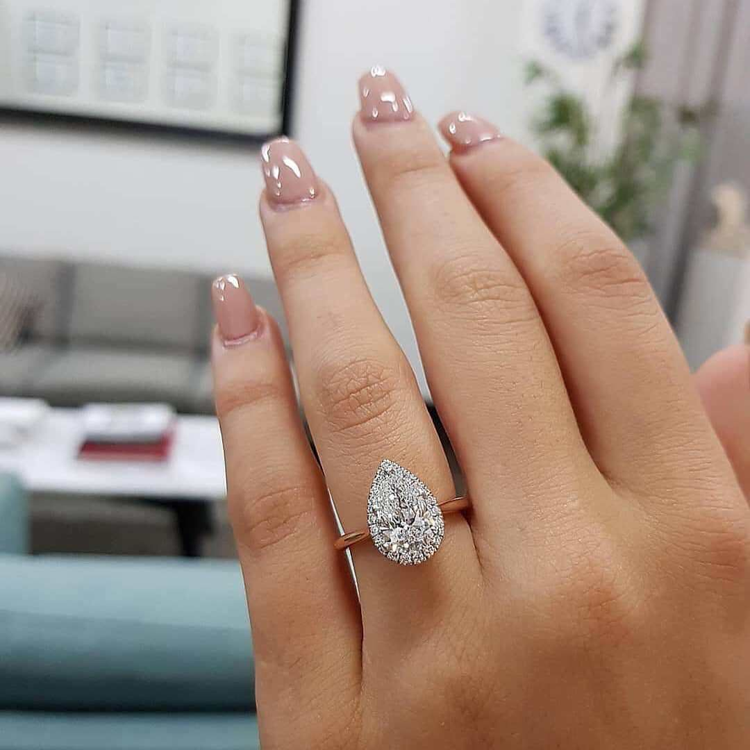 Tear drop halo engagement ring