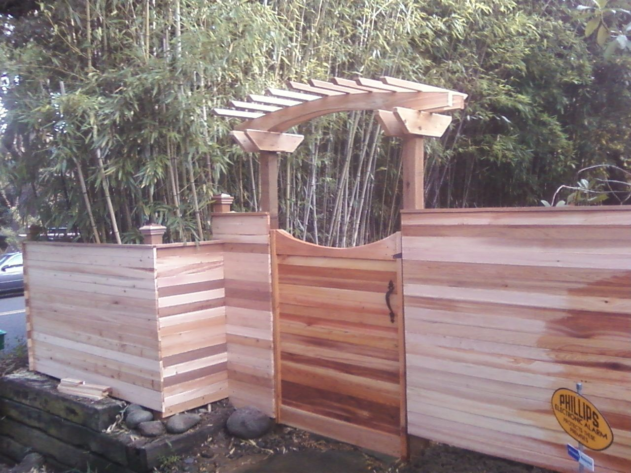 Custom built cedar fence with horizontal boards