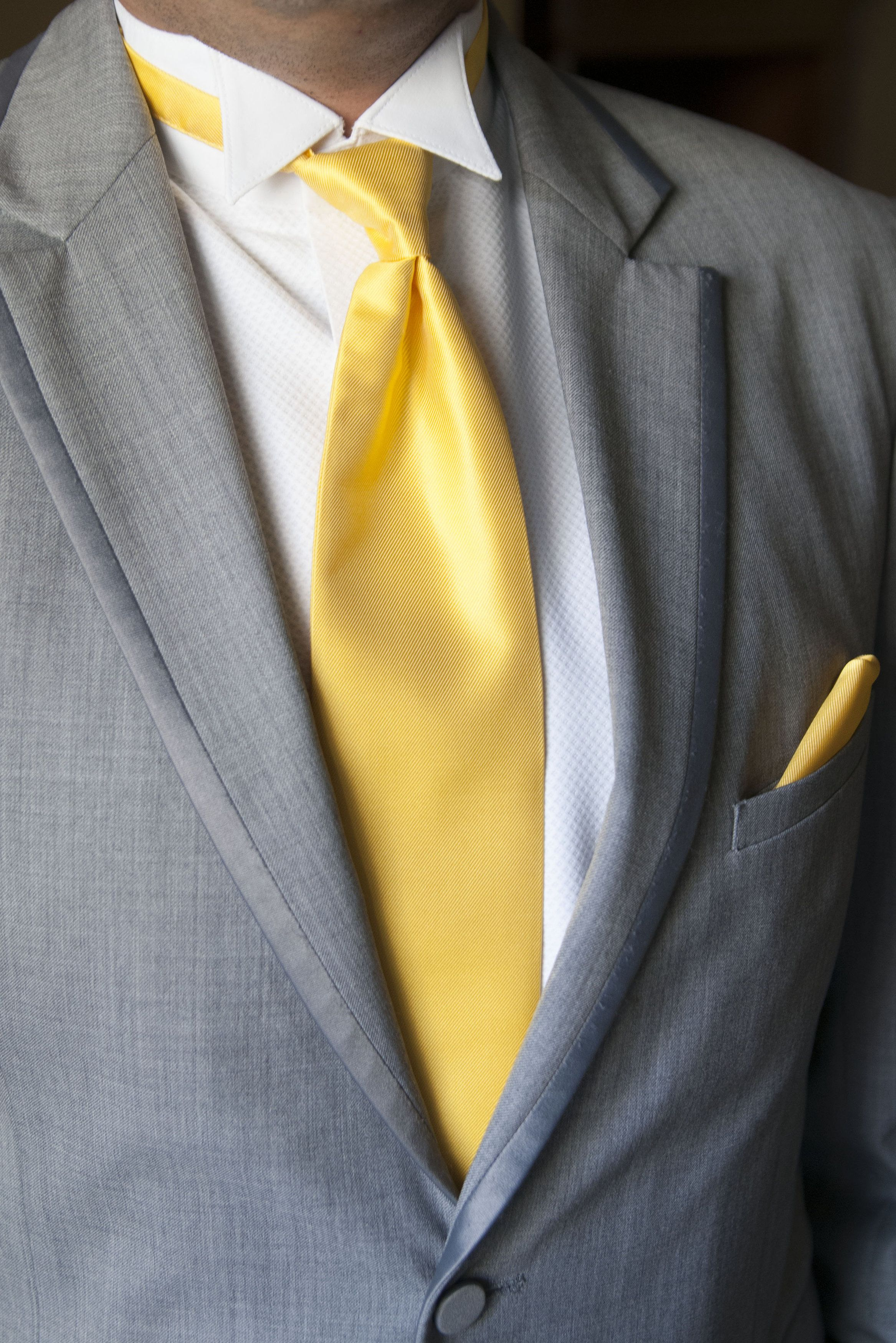 grey suit with yellow tie in 2019