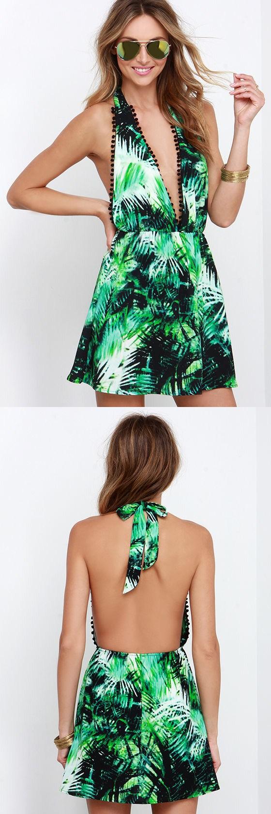 Fronds green tropical print halter dress has a bold botanical print