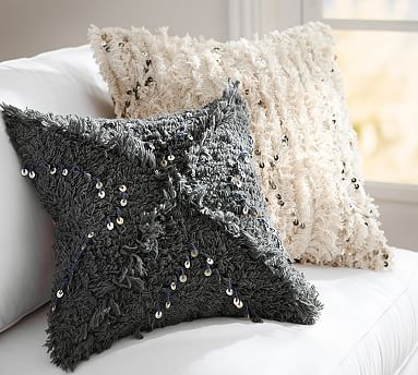 I like the elegance of simple decor but I like to add just a little sparkle too, like these pillows from Pottery Barn.