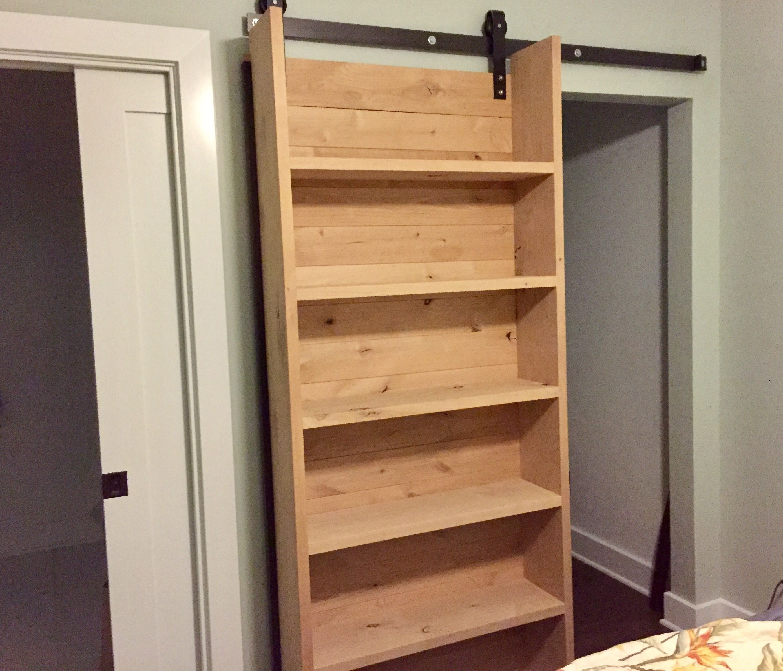 Our Rad New Sliding Closet Bookshelf Barndoor Thanks Tommie Silva Diy Sliding Door Barn Door Bookcase Sliding Door Bookcase