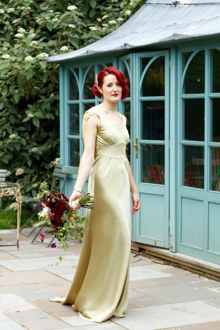 1b2550cbbb2 A gold bias cut wedding dress by Kate Beaumont for a vintage inspired  country wedding at Walcott Hall. Photography by Milly Colley.