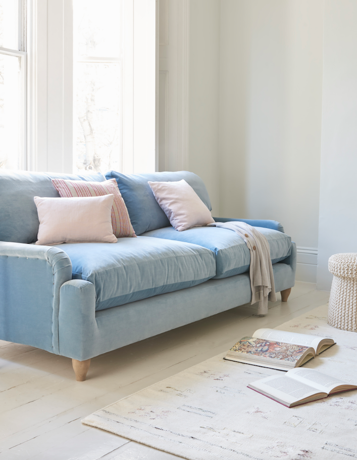 Sofa Upholstered In A Light Blue Velvet