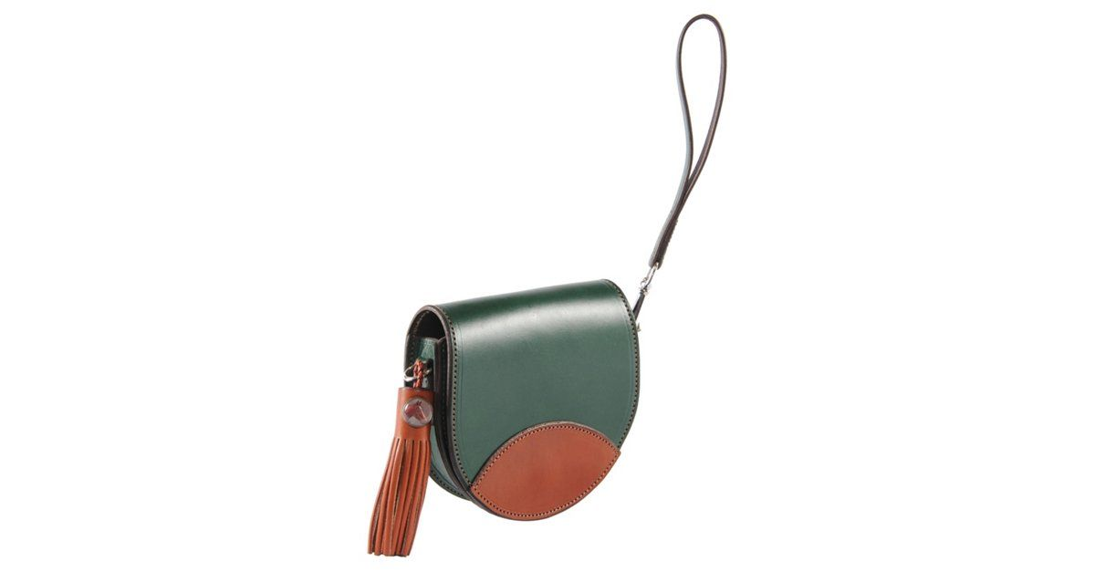 This multi-purpose mini clutch multi-tasks as fast as you do. The bag can be worn three ways: use the short handle for a wristlet, the long shoulder strap to carry it cross-body, or take the straps...
