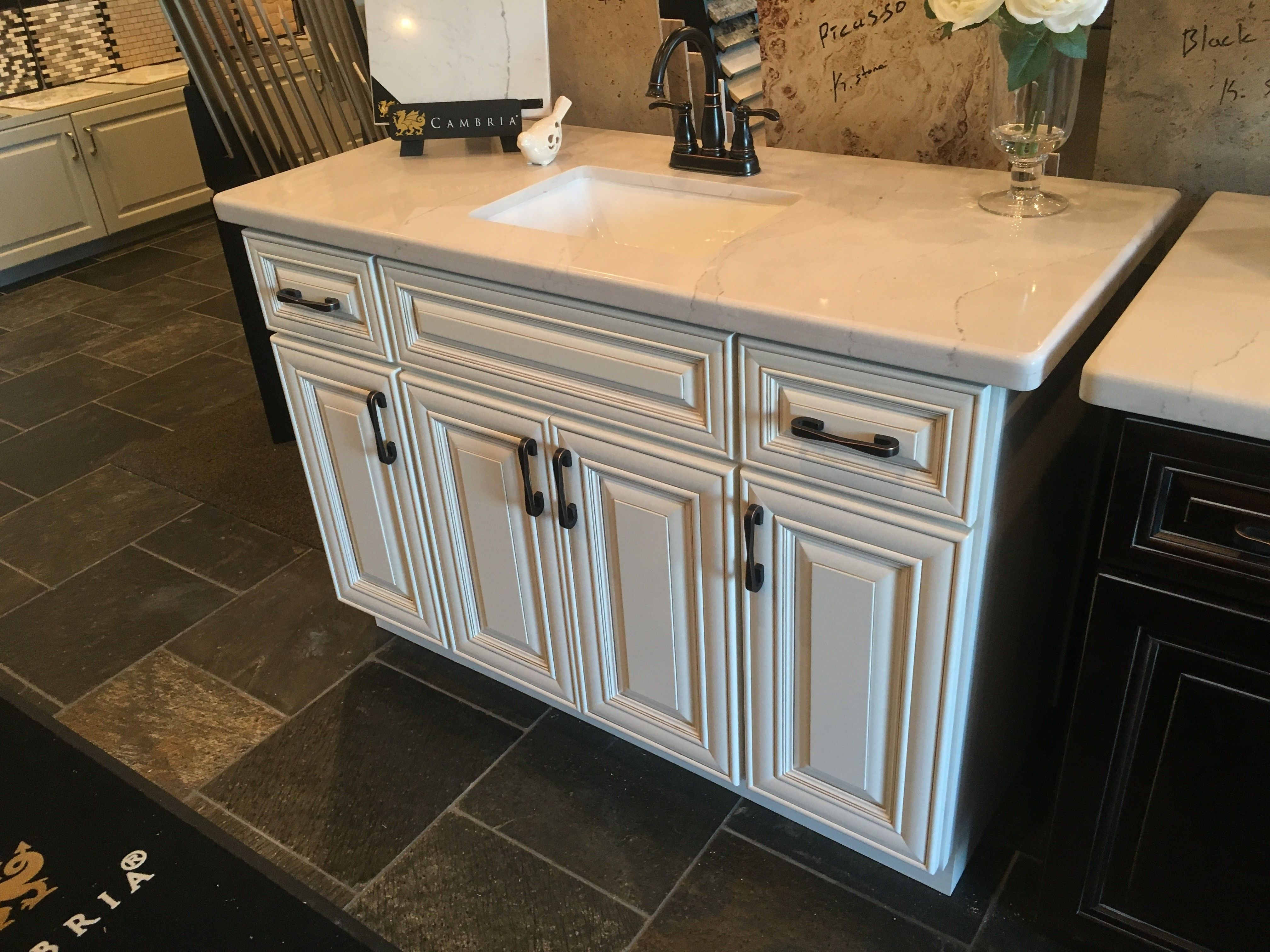 Vintage Oatmeal Raised Panel Cabinetry W Quartz Countertops Bronze Hardware Pulls Kitchen Cabinets And Granite Kitchen Cabinets Kitchen Remodel