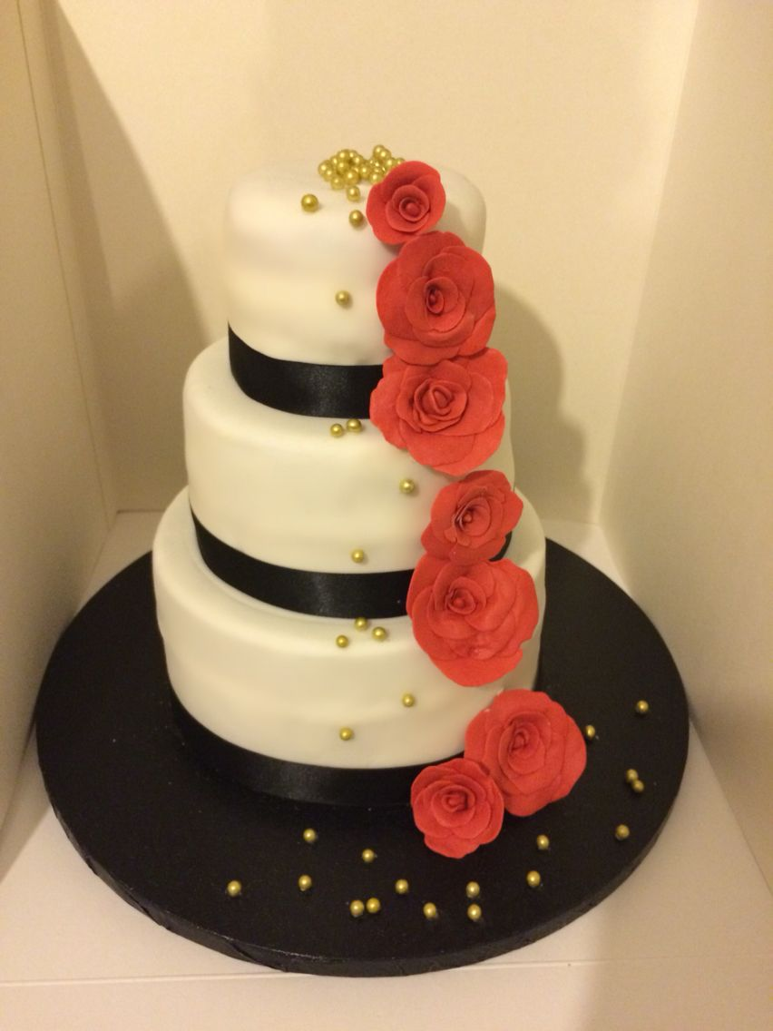 Amateur 3 tier chocolate wedding cake in black, red and gold. With ...