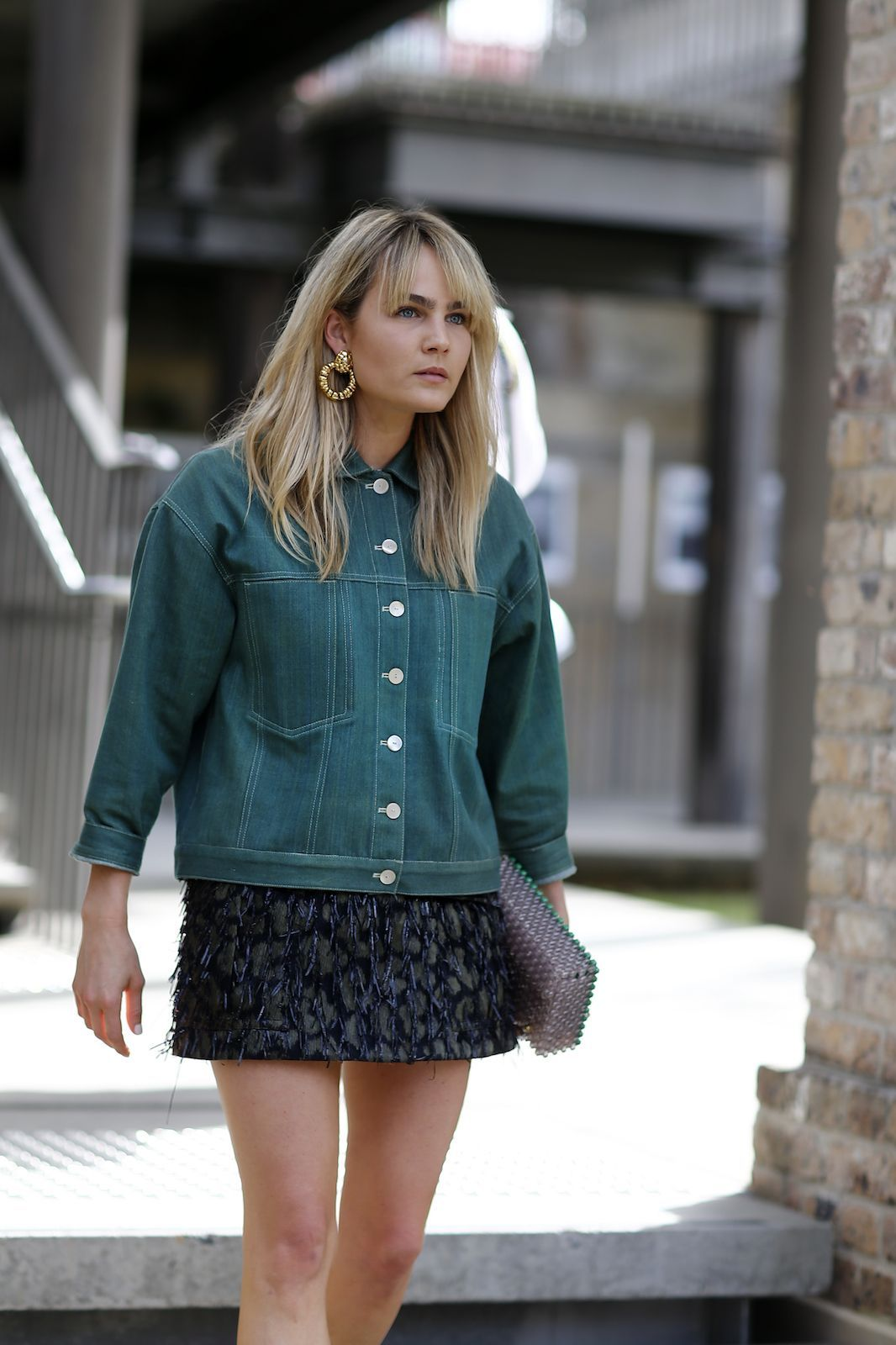 Go for mod vibes with a boxy jacket, mini skirt, and gold hoop earrings. #refinery29 http://www.refinery29.com/2016/05/111596/sydney-fashion-week-resort-2016-street-style-pictures#slide-31