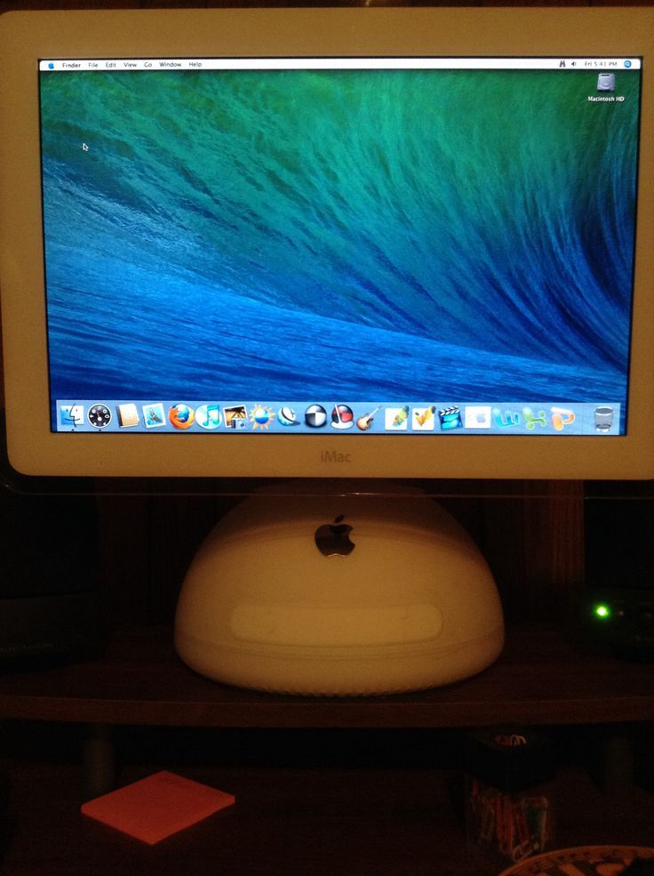 Classic iMac with cool Mac OS X Mavericks wallpaper .