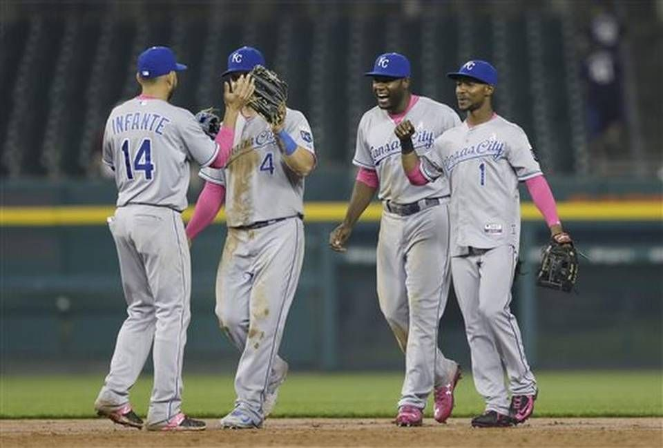 Kansas City Royals from left, Omar Infante, Alex Gordon, Lorenzo Cain and Jarrod Dyson celebrate their 2-1 win over the Detroit Tigers after the tenth inning of a baseball game, Monday, May 11, 2015, in Detroit. (AP Photo/Carlos Osorio)