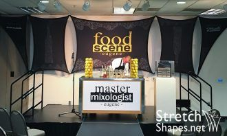 Dye sub printed panels create a dynamic backdrop for this foodie festival.