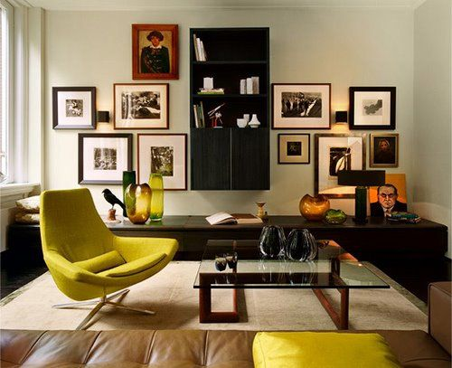I like the gallery wall arrangement and low slung credenza.This could be a good set up for my TV room. Not so keen on the rest of it, but it probably looks awesome in person. Design by Kate Hume #gallerywall