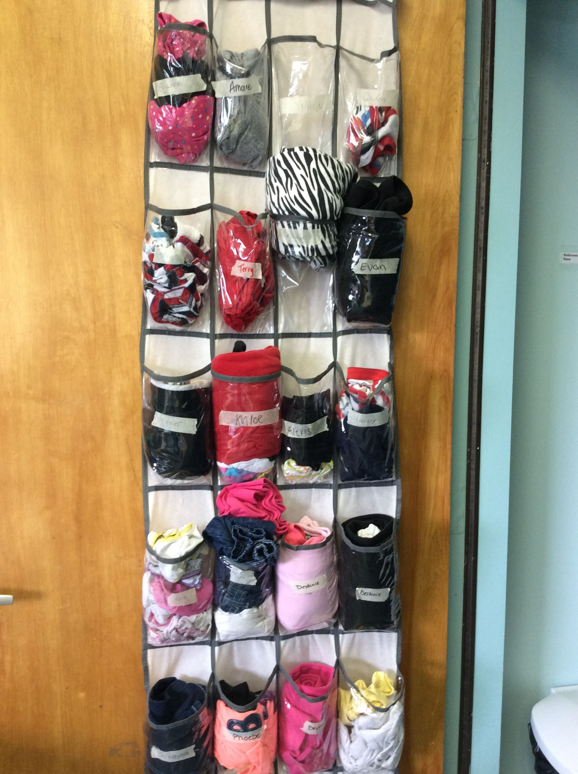 A Re Purposed Shoe Rack Serves As An Excellent Way To Store And Keep Track Of Extra Clothes Good Thinking Sunshi Preschool Decor Classroom Storage Hat Storage