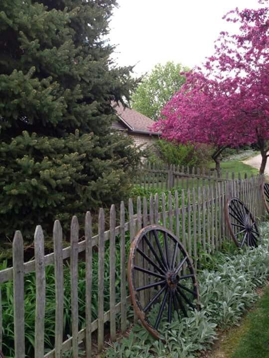 wagon wheels against fence at currys antiques 2015 spring - Rustic Garden 2015