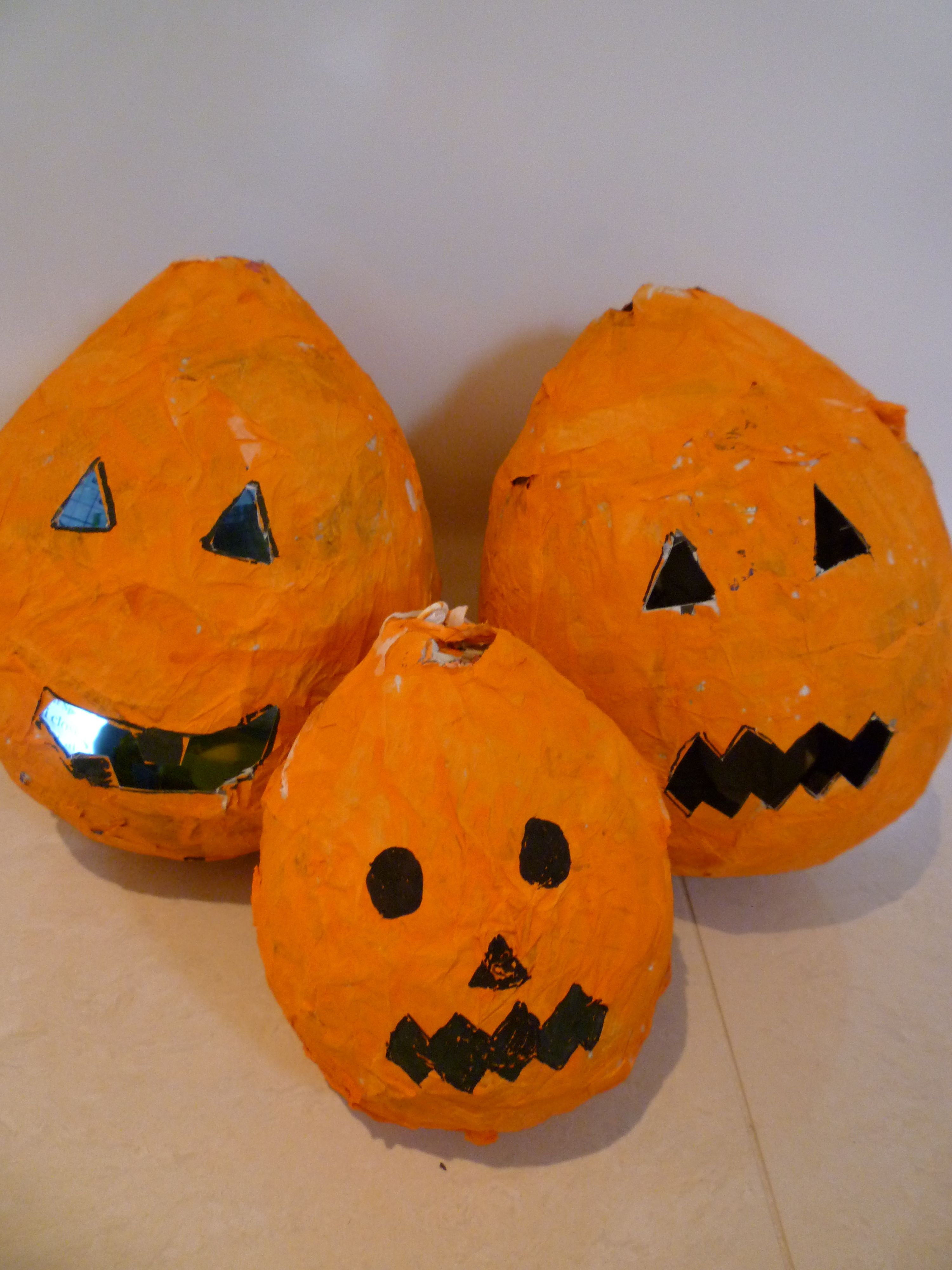 Papier mache pumpkins - you can even put a small torch inside to light them up! .... at ...